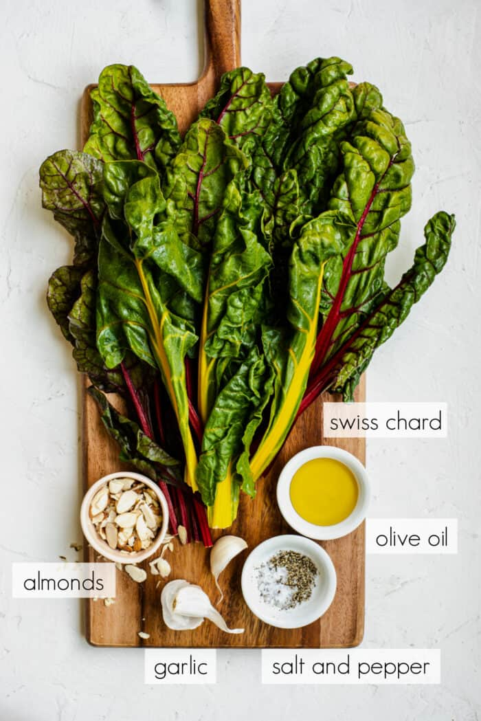 ingredients for sauteed chard on a cutting board
