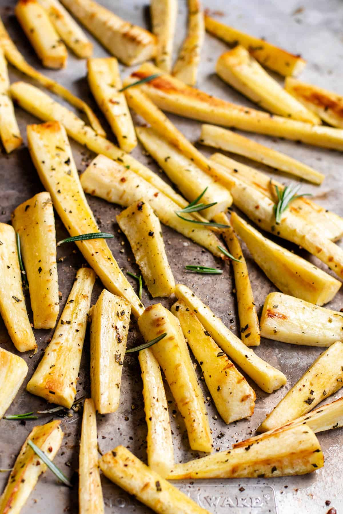easy toasted parsnips on a piece of parchment paper