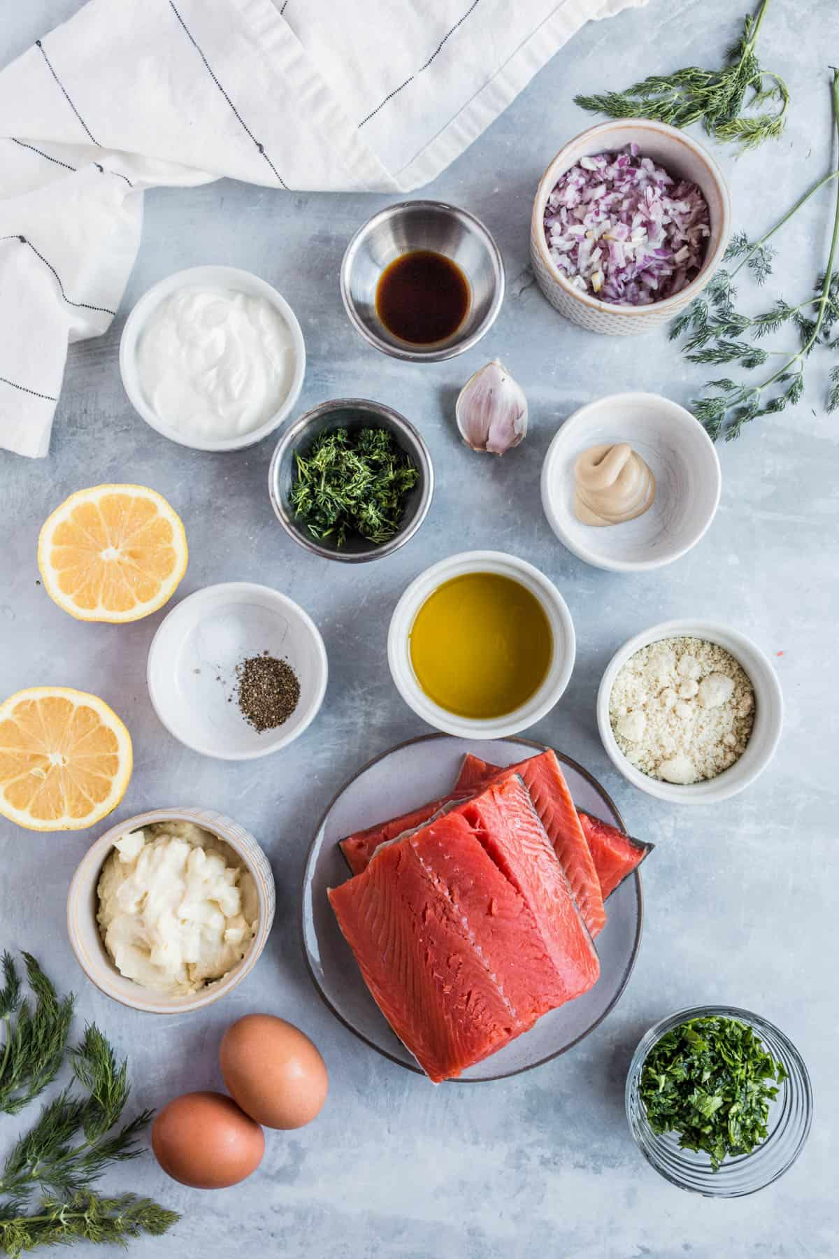 all of the ingredients for salmon patties on a grey countertop