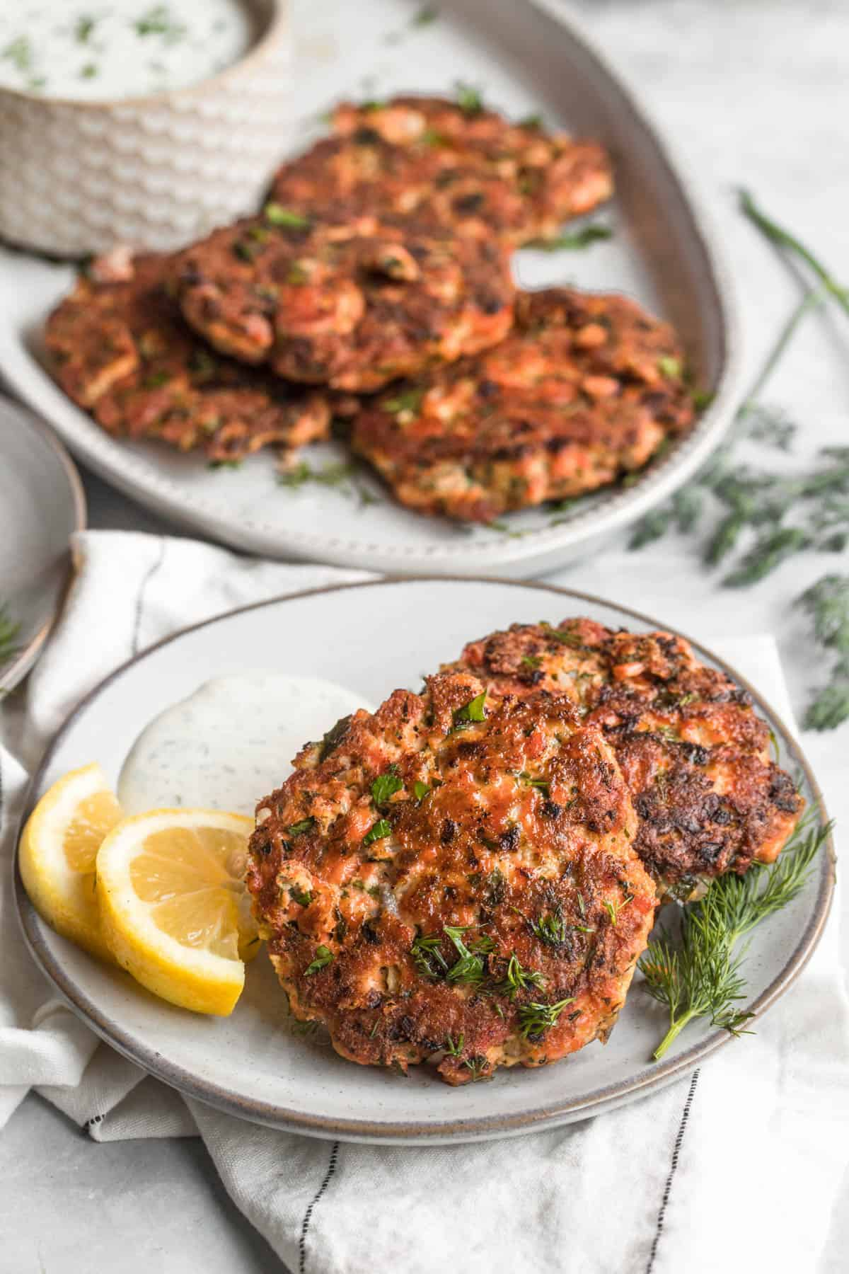 two salmon patties on a plate